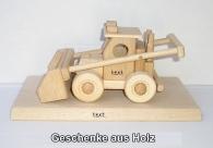 Landwirtschaftliche Lader Spielzeug an der Basis des Geschenks
