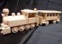 Eine Schmalspurlokomotive mit einer persönlichen Wagen